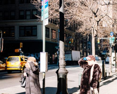 women bus stop